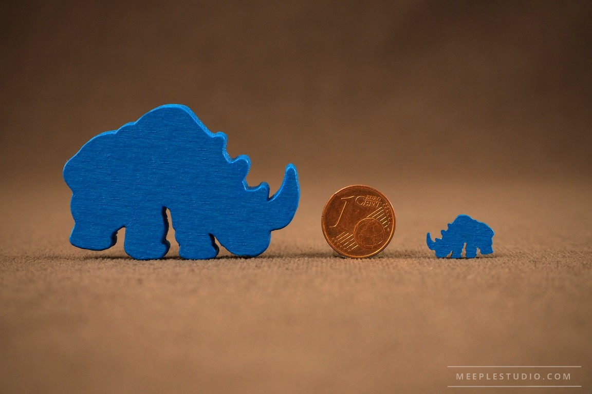 meeple  showing the scale small and big meeple on a coin background